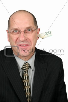 Business Man with Money Out of his Ear