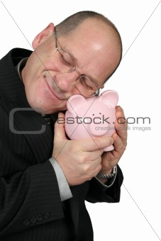 Business Man Hugging Piggy Bank