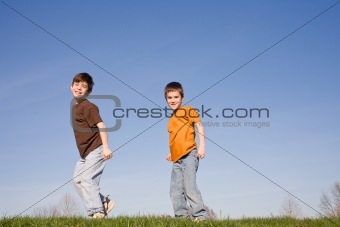 Boys Walking on a Hill