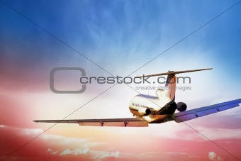 Aircraft flying into sunset