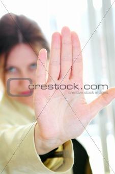 Mature woman gesturing stop
