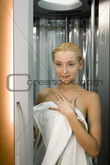 Blond girl in the solarium