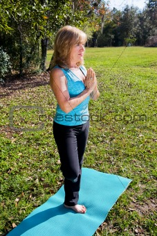 Mature Woman Yoga - Trees