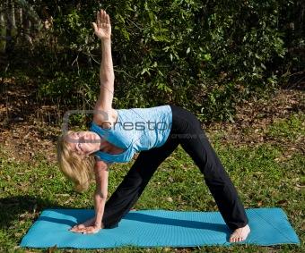 Mature Woman Yoga - Triangle Pose