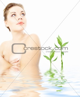 clean lady in water with green plants #2