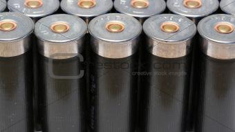 12 gage black shotgun shells background