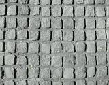 Background Picture: Driveway of grey granite paving stones in concrete