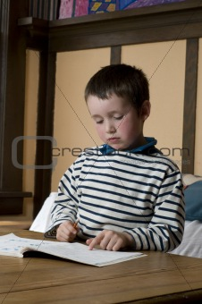 1st grade boy doing homework