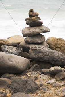 A pile of rocks on a beach.