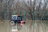 flood on the danube - tractor in water