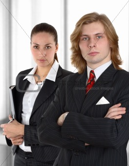 business couple before window