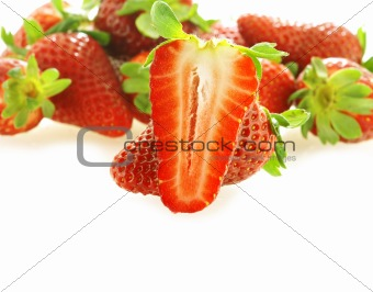 one cut fresh ripe strawberry and few as background