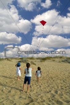 three kids and red kite