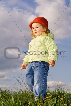 Little girl in the early spring afternoon