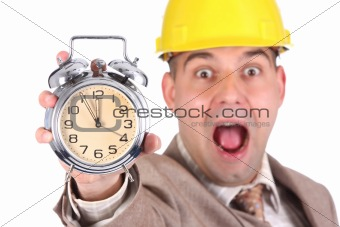 businessman looking at clock alarm