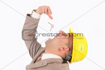 A businessman engulf keys