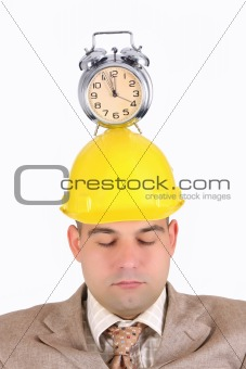 sleepy businessman with clock alarm