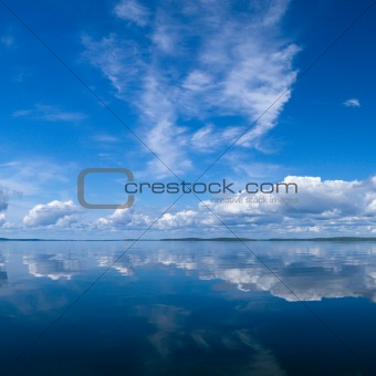 Summer sky reflecting in lake