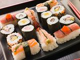 Selection of Seafood and Vegetable Sushi on a Tray with chopstic