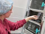 Embryologist putting sample into incubator