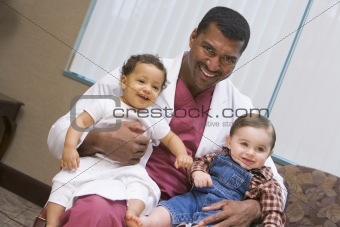 Consultant holding two IVF children