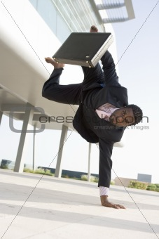 Athletic businessman outside office