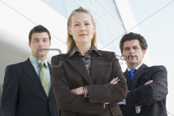 Three businesspeople outside office