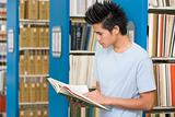 University student reading in library