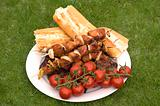 grilled barbecue meat and bread and tomatoes