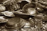 gold pans in sepia