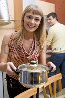 Woman with saucepan