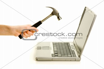 Smashing laptop with a hammer