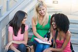 Group of female university students on steps
