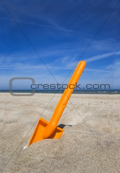 Orange plastic beache spade