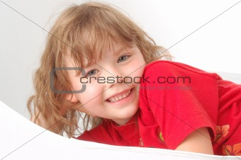 Portrait of little girl on red.