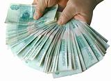 Hands holding many of the Russian banknotes
