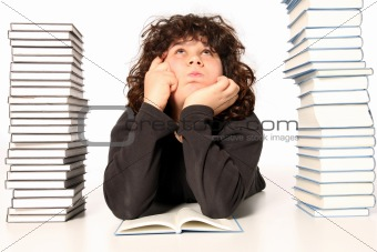 boy thinking and reading a book