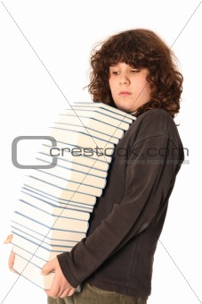 boy carrying books on head
