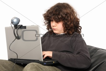 boy using laptop and webcam