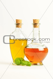 Olive Oil and Vinegar with Basil isolated over white background