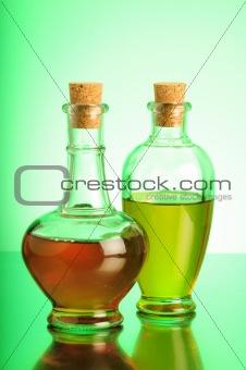 Olive Oil and Vinegar on green backgroundOlive Oil and Vinegar on brown background