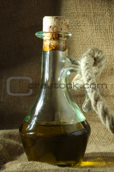 Olive oil with rope and canvas sack