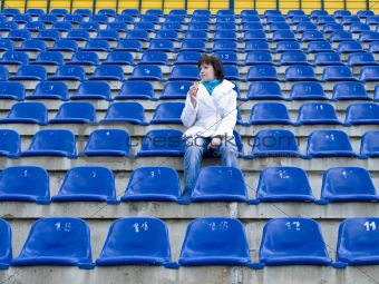 Single woman at stadium