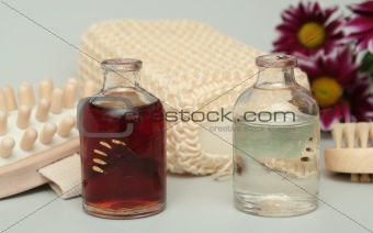 Cosmetic accessories and two bottles with oil and