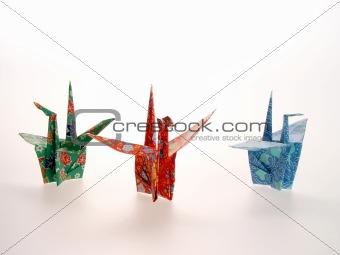 Three Oragami  Cranes of different colors