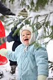 Kid with snowy branch