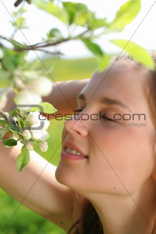 Girl with apple tree flowers
