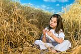 littel girl in a wheat field