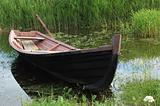 Old wooden boat at riverbank