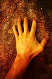 Hand on stone